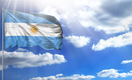 Flag of Argentina on a flagpole against a blue sky, with a good place for your text.