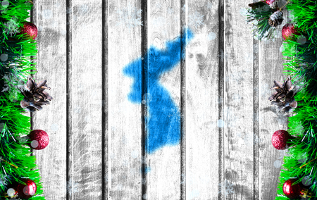 Wooden Christmas background with blurred flag of Korean Unification. There is a place for your text in the photo. 스톡 콘텐츠