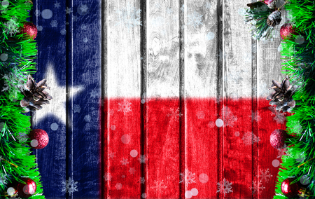 Wooden Christmas background with blurred flag State of Texas. There is a place for your text in the photo. Standard-Bild