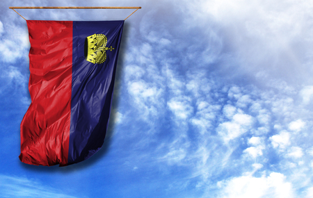 Flag of Liechtenstein. Vertical flag, against blue sky with place for your text Banco de Imagens