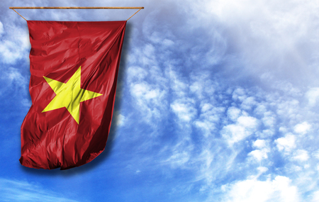 Flag of Vietnam. Vertical flag, against blue sky with place for your text
