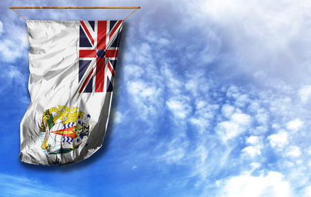 Flag of British Antarctic Territory. Vertical flag, against blue sky with place for your text