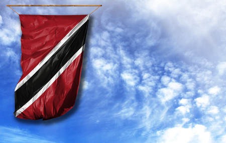 Flag of Trinidad and Tobago. Vertical flag, against blue sky with place for your text Stok Fotoğraf