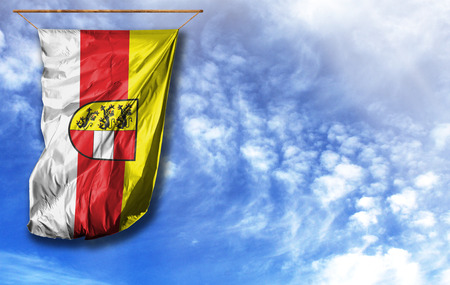 Flag of Carinthia. Vertical flag, against blue sky with place for your text