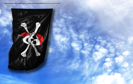 Flag of pirate. Vertical flag, against blue sky with place for your text