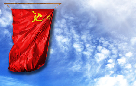 Flag of USSR. Vertical flag, against blue sky with place for your text