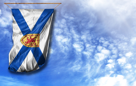 Flag of Nova Scotia. Vertical flag, against blue sky with place for your text