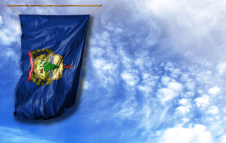 Flag State of Vermont. Vertical flag, against blue sky with place for your text Stock Photo