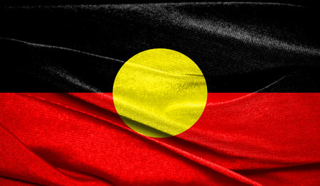 Realistic flag of Australian Aboriginal on the wavy surface of fabric. Perfect for background or texture purposes.