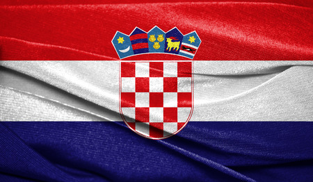 Realistic flag of Croatia on the wavy surface of fabric. Perfect for background or texture purposes.