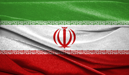 Realistic flag of Iran on the wavy surface of fabric. Perfect for background or texture purposes. 写真素材