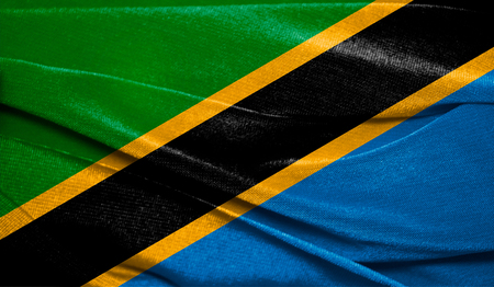 Realistic flag of Tanzania on the wavy surface of fabric. Perfect for background or texture purposes. 스톡 콘텐츠