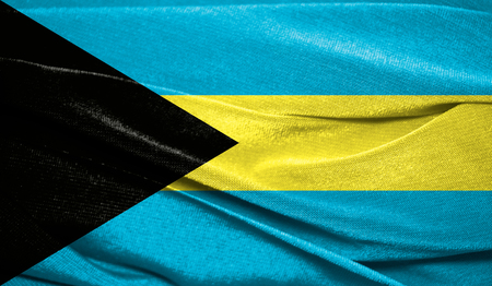 Realistic flag of Bahamas on the wavy surface of fabric. Perfect for background or texture purposes.