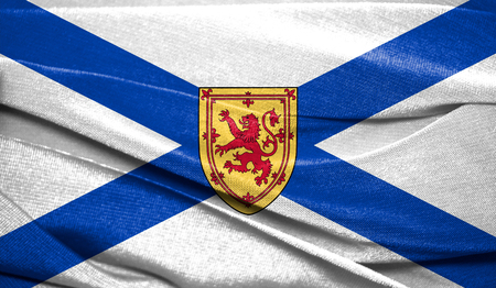 Realistic flag of Nova Scotia on the wavy surface of fabric. Perfect for background or texture purposes.