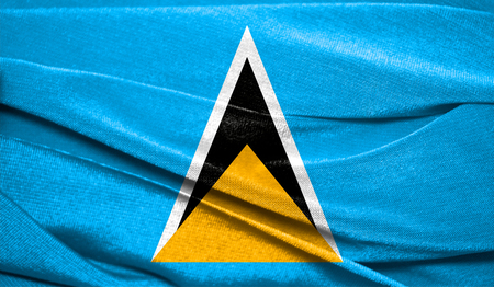 Realistic flag of Saint Lucia on the wavy surface of fabric. Perfect for background or texture purposes.