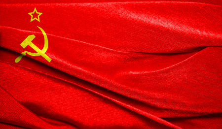 Realistic flag of USSR on the wavy surface of fabric. Perfect for background or texture purposes.