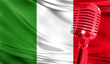Microphone on fabric background of flag of Italy close-up