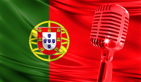Microphone on fabric background of flag of Portugal close-up