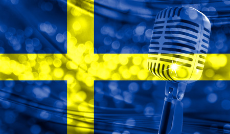 Microphone on a background of a blurry Sweden flag close-up