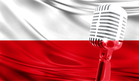 Microphone on fabric background of flag of Poland close-up