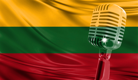 Microphone on fabric background of flag of Lithuania close-up
