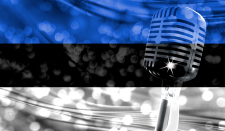 Microphone on a background of a blurry Estonia flag close-up