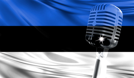 Microphone on fabric background of flag of Estonia close-up