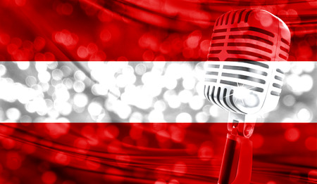 Microphone on a background of a blurry Austria flag close-up