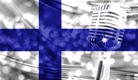 Microphone on a background of a blurry Finland flag close-up