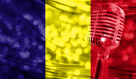Microphone on a background of a blurry Romania flag close-up Stock Photo
