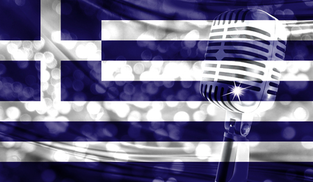 Microphone on a background of a blurry Greece flag close-up Stock Photo