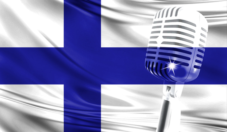 Microphone on fabric background of flag of Finland close-up