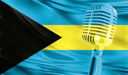 Microphone on fabric background of flag of Bahamas close-up