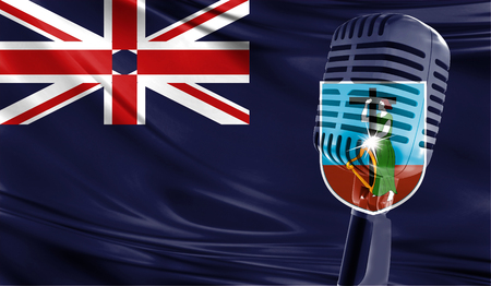 Microphone on fabric background of flag of Montserrat close-up