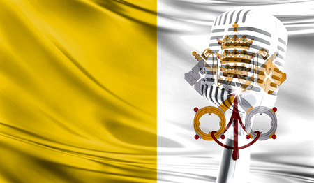 Microphone on fabric background of flag of Vatican city Holy see close-up