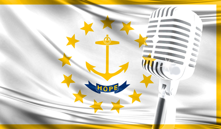 Microphone on fabric background of flag State of Rhode Island and Providence Plantations close-up