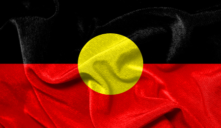 Realistic flag of Australian Aboriginal on the wavy surface of fabric Stock Photo
