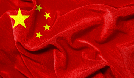Realistic flag of China on the wavy surface of fabric Imagens