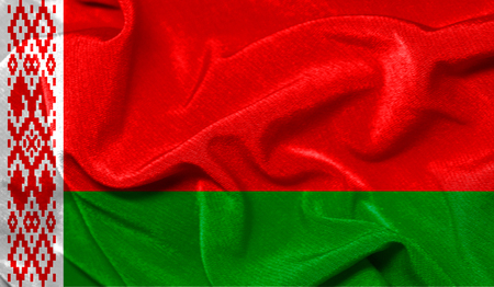 Realistic flag of Belarus on the wavy surface of fabric Imagens