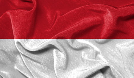 Realistic flag of Indonesia on the wavy surface of fabric