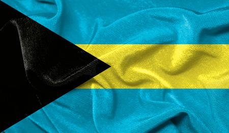 Realistic flag of Bahamas on the wavy surface of fabric Stock Photo