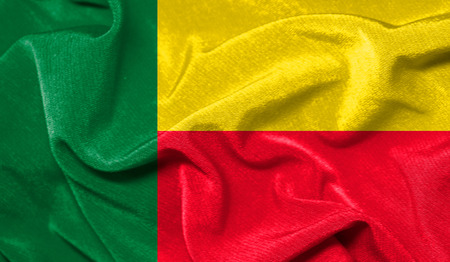 Realistic flag of Benin on the wavy surface of fabric