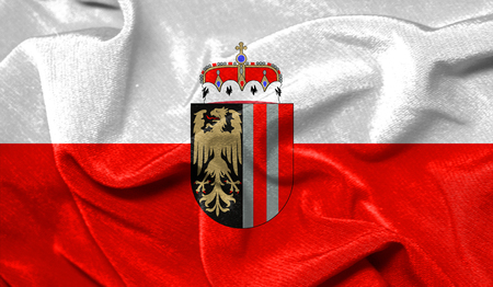 Realistic flag of Upper Austria on the wavy surface of fabric Banque d'images - 116711261