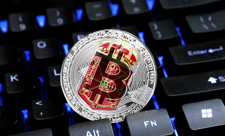 Bitcoin close-up on keyboard background, the flag of Navarra coat of arms is shown on bitcoin.
