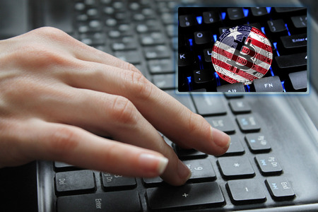 Hand of the girl on the keyboard close up with the concept of digital technology on the purchase and sale of crypto currency bitcoin with a flag of Liberia. The concept of network, communication, technology. Standard-Bild