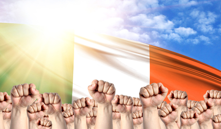 Labor Day concept with fists of men against the background of the flag of Ireland