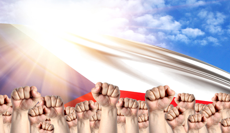 Labor Day concept with fists of men against the background of the flag of Czech Republic