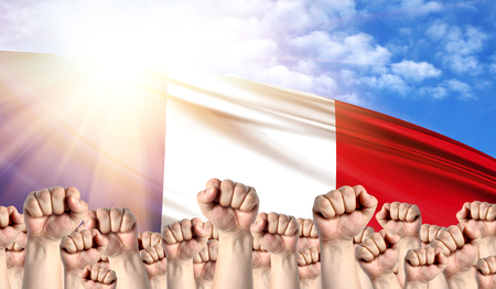 Labor Day concept with fists of men against the background of the flag of France