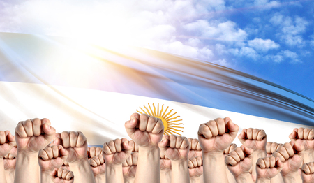 Labor Day concept with fists of men against the background of the flag of Argentina Stock Photo