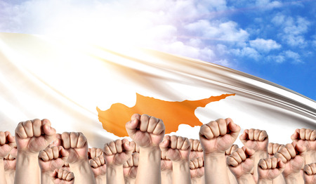 Labor Day concept with fists of men against the background of the flag of Cyprus
